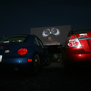 The Valle Drive-In in Newton, Iowa, is one of only four outdoor movie theaters left in the state.  By showing recent releases, like the hit movie, WALL-E, the Valle is able to stay in business. ..The oldest of Iowa's operating Drive-ins (since 1948), the Valle.has had four sets of owners down through the years,.but has been run by the current owner and operating.continuously since 1976.  ..Double features are shown nightly, and .there are still some functional traditional speakers.in addition to AM/FM radio broadcasting of the audio.which is now enhanced with DTS digital processing...