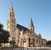 Collegiale Notre-Dame de Poissy, showing the Western bell tower and portico, a catholic parish church founded c. 1016 by Robert the Pious and rebuilt 1130-60 in late Romanesque and early Gothic styles, in Poissy, Yvelines, France. Saint Louis was baptised here in 1214. The Collegiate Church of Our Lady of Poissy was listed as a Historic Monument in 1840 and has been restored by Eugene Viollet-le-Duc. Picture by Manuel Cohen