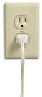 a white U.S. plug in an electrical outlet photographed on a white background