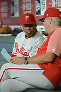 PHOENIX, AZ - JUNE 23:  Third base coach Juan Samuel #8 listens to manager Pete Mackanin #45 of the Philadelphia Phillies in the dugout during the MLB game against the Arizona Diamondbacks at Chase Field on June 23, 2017 in Phoenix, Arizona. The Philadelphia Phillies won 6-1.  (Photo by Jennifer Stewart/Getty Images)