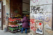 A woman shopper choses produce from a fruit and vegetable stall in Smichov district, Prague 5, on 19th March, 2018, in Prague, the Czech Republic.