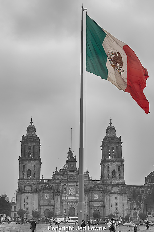 "The Zocalo in Mexico City is one of the largest squares in the world, approximately 787ft x 787 ft.  Right in the middle stands a flag pole with a large flag pictured here.  Behind is the Cathedral and to the right, not pictured, is the National Palace where the President declares ""Viva Mexico"" every year on their independence."