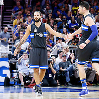 25 February 2017: Orlando Magic guard Evan Fournier (10) is congratulated by Orlando Magic center Nikola Vucevic (9) during the Orlando Magic 105-86 victory over the Atlanta Hawks, at the Amway Center, Orlando, Florida, USA.