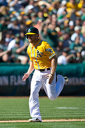 OAKLAND, CA - SEPTEMBER 22: Brandon Moss #37 of the Oakland Athletics scores a run against the Minnesota Twins during the fifth inning at O.co Coliseum on September 22, 2013 in Oakland, California. The Oakland Athletics defeated the Minnesota Twins 11-7 as they clinched the American League West Division. (Photo by Jason O. Watson/Getty Images) *** Local Caption *** Brandon Moss