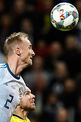 November 20, 2018 - Stockholm, Sweden - Marcus Berg (bottom) of Sweden and Vladislav Ignatyev of Russia vie for a header during the UEFA Nations League B Group 2 match between Sweden and Russia on November 20, 2018 at Friends Arena in Stockholm, Sweden. (Credit Image: © Mike Kireev/NurPhoto via ZUMA Press)