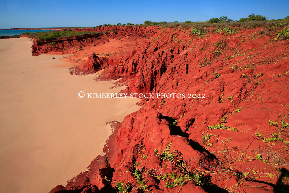 Red pindan cliffs meet the beach at James Price Point on the Kimberley's Dampier Peninsular.