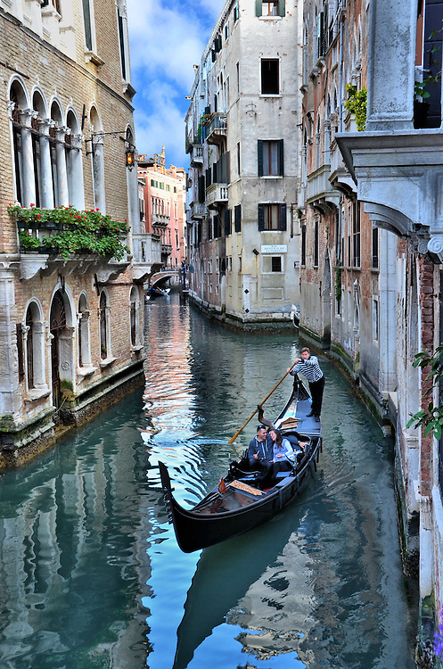 Romantic Couple in Gondola on Canal in Venice, Italy<br />