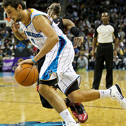 November 5, 2010; New Orleans, LA, USA; New Orleans Hornets shooting guard Marco Belinelli (8) of Italy drives past Miami Heat shooting guard Dwyane Wade (3) during the second half at the New Orleans Arena. The Hornets defeated the Heat 96-93. Mandatory Credit: Derick E. Hingle