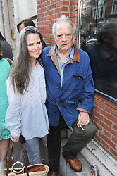 KOO STARK and DAVID BAILEY at a private view of photographs by David Bailey entitled 'Then' held at Hamiltons, 13 Carlos Place, London W1 on 6th July 2010.