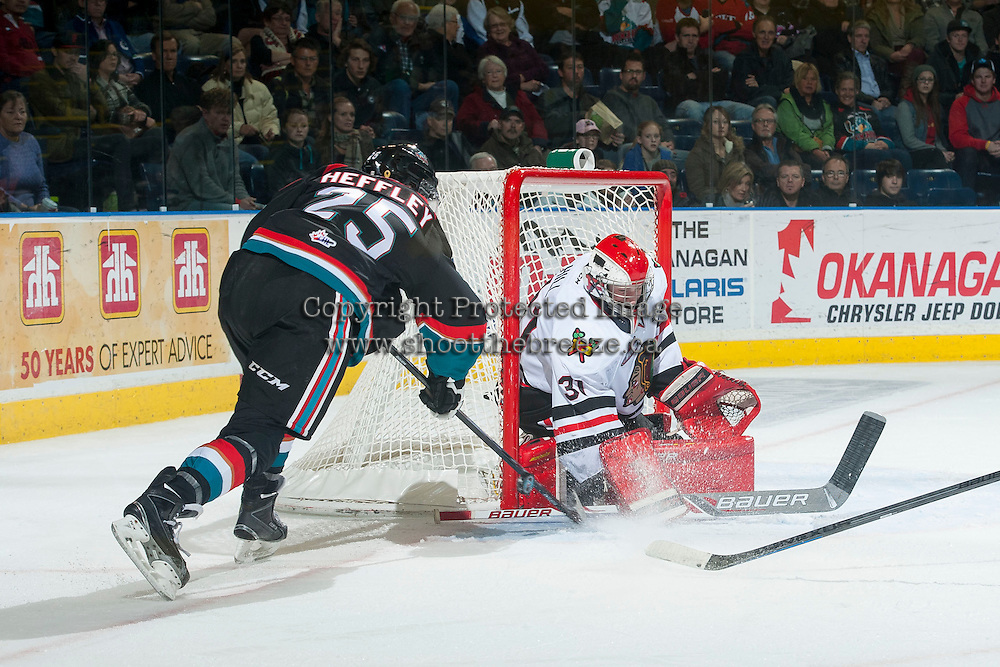 KELOWNA, CANADA - NOVEMBER 22: Colton Heffley #25 of Kelowna Rockets tries to put the puck in the net as Adin Hill #31 of Portland Winterhawks deflects the shot on November 22, 2014 at Prospera Place in Kelowna, British Columbia, Canada.  (Photo by Marissa Baecker/Shoot the Breeze)  *** Local Caption *** Colton Heffley; Adin Hill;