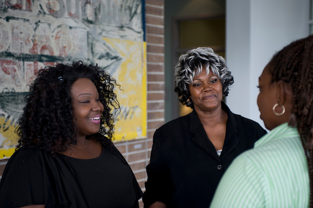 Photograph of Star of Hope residents receiving keys at the New Hope Housing Perry Street Development, an SRO community that officially celebrated completion and opening on October 25, 2012. NHH and Star of Hope agreement provides housing for SOH people and these ladies are the first residents at this property.