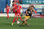 York City midfielder James Barrett shot blocked by Cambridge United defender Mark Roberts  during the Sky Bet League 2 match between York City and Cambridge United at Bootham Crescent, York, England on 3 October 2015. Photo by Simon Davies.