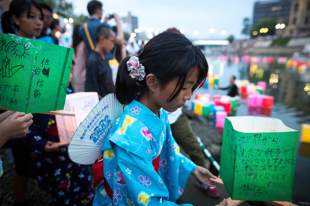 HIROSHIMA, JAPAN - AUGUST 6 : People wait to float candle lit lantern with their written message on the Motoyasu River during the 71st anniversary activities, commemorating the atomic bombing of Hiroshima at the Hiroshima Peace Memorial Park on August 6, 2016 in Hiroshima, western Japan. Japan marks the 71st anniversary of the first atomic bomb that was dropped by the United States on Hiroshima on August 6, 1945 during World War II.  (Photo by Richard Atrero de Guzman/NURPhoto)