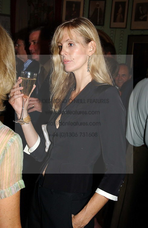 CARINA COOPER writer of the Notting Hill Cook Book at a party for interior designer Katherine Ireland held at Marks club, 46 Charles Street, London W1 on 27th September 2004.<br />