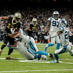 Dec 30, 2018; New Orleans, LA, USA; New Orleans Saints wide receiver Michael Thomas (13) breaks a franchise record for receiving yards in a season on a catch against the Carolina Panthers during the fourth quarter at the Mercedes-Benz Superdome. Mandatory Credit: Derick E. Hingle-USA TODAY Sports