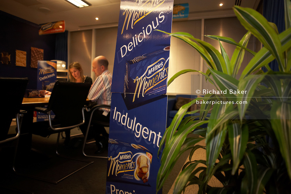 A creative biscuit-making team exchange new marketing ideas in a private room at the United Biscuits Group offices, Hayes London