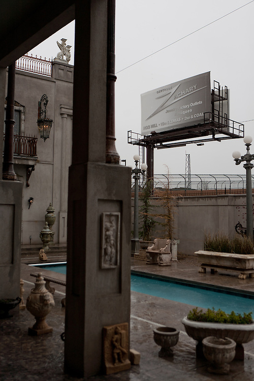 A billboard for Gertrude Zachary's businesses looms over her backyard in downtown Albuquerque New Mexico...CREDIT: Steven St. John for The Wall Street Journal