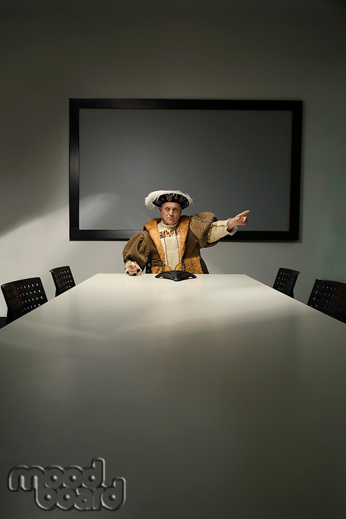 King Henry VIII pointing in conference room