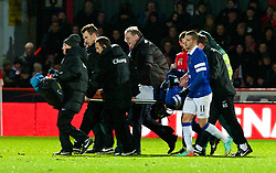 STEVENAGE, ENGLAND - Saturday, January 25, 2014: Everton's Bryan Oviedo is carried off injured as team-mate Kevin Mirallas looks on concerned during the FA Cup 4th Round match against Stevenage at Broadhall Way. (Pic by Tom Hevezi/Propaganda)