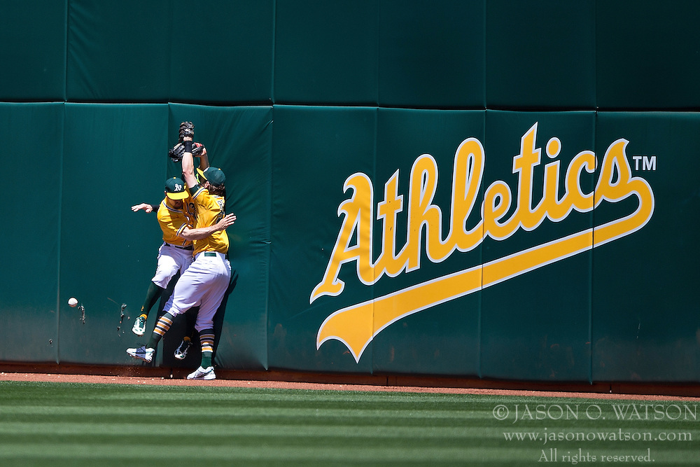 OAKLAND, CA - JUNE 18:  Billy Burns #1 of the Oakland Athletics and Josh Reddick #22 collide in the outfield attempting to field a fly ball hit off the bat of Melvin Upton Jr. (not pictured) of the San Diego Padres during the eighth inning at O.co Coliseum on June 18, 2015 in Oakland, California. The San Diego Padres defeated the Oakland Athletics 3-1. (Photo by Jason O. Watson/Getty Images) *** Local Caption *** Billy Burns; Josh Reddick