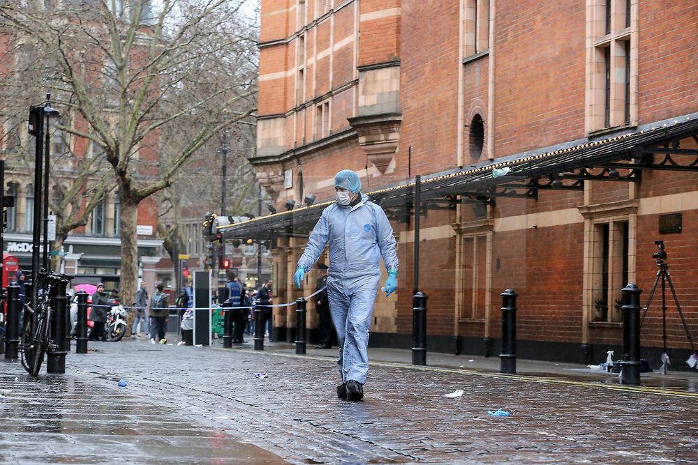 © Licensed to London News Pictures. 03/03/2019. London, UK. Crime scene outside The Coach and Horses pub in Romilly Street in Soho. According to the police, a man aged 30 yrs old is seriously injured in hospital and a woman has been arrested. Photo credit: Dinendra Haria/LNP