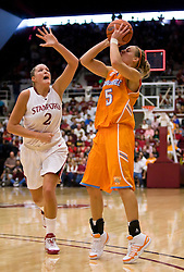 December 19, 2009; Stanford, CA, USA;  Tennessee Lady Volunteers guard/forward Angie Bjorklund (5) is defended by Stanford Cardinal forward/center Jayne Appel (2) as the shot clock expires during the second half at Maples Pavilion.  Stanford defeated Tennessee 67-52.