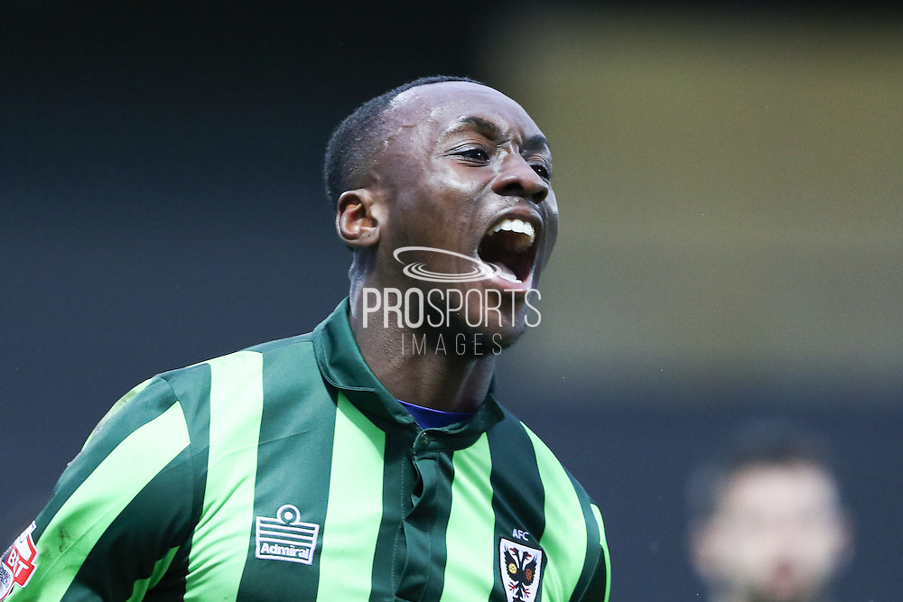 a jubilant Ade Azeez of AFC Wimbledon scores what proves to be the winner during the Sky Bet League 2 match between Barnet and AFC Wimbledon at Underhill Stadium, London, England on 20 February 2016. Photo by Stuart Butcher.