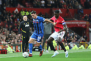 Rochdale's Ian Henderson holds the ball from Manchester United's Alex Tuanzebe during the EFL Cup match between Manchester United and Rochdale at Old Trafford, Manchester, England on 25 September 2019.
