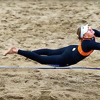 Nederland, Scheveningen, 03-06-2012.<br /> Volleybal, Beach volleybal.<br /> Europees Kampioenschap, Finale, Vrouwen.<br /> Marleen van Iersel, hier zwevend naar de bal in de finale , en Sanne Keizer hebben voor het eerst in hun loopbaan de Europese titel beachvolleybal veroverd. Het Nederlandse duo was in de finale op het strand in Scheveningen met 21-17 21-11 te sterk voor het Griekse tweetal Maria Tsiartsiani en Vasiliki Arvaniti. <br /> Foto : Klaas Jan van der Weij