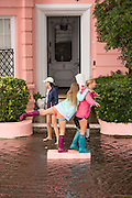 A group of college students play along the flooded streets of the Battery in the historic district as Hurricane Joaquin brings heavy rain, flooding and strong winds as it passes offshore October 4, 2015 in Charleston, South Carolina.
