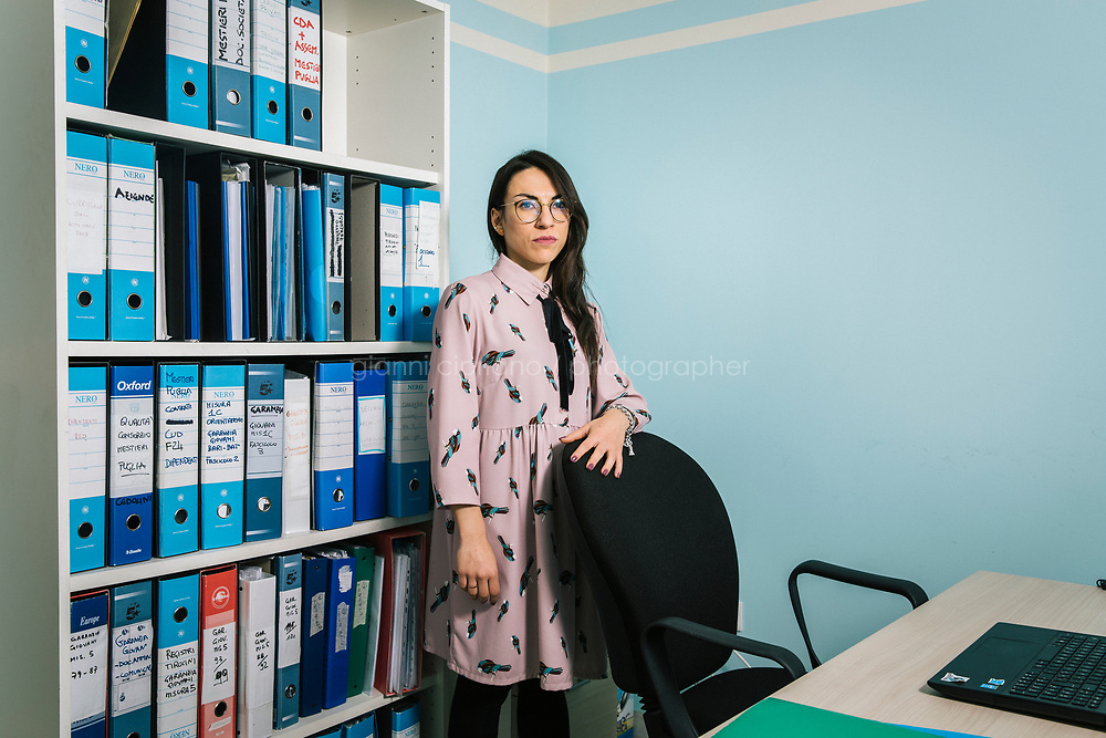 BARI, ITALY - 21 FEBRUARY 2018: Emanuela Muolo (28)  poses for a portrait at her workplace at Consorzio Mestieri Puglia, a job center trying to find other people work, in Bari, Italy, on February 21st 2018.<br /> <br /> Emanuela was hired thanks to the Garanzia Giovani, an EU Youth Employment Initiative that has provided direct support to over 1.6 million young people across the EU. Emanuela Muolo sees the elections as pointless, though her boyfriend will vote the Five Stars Movement.