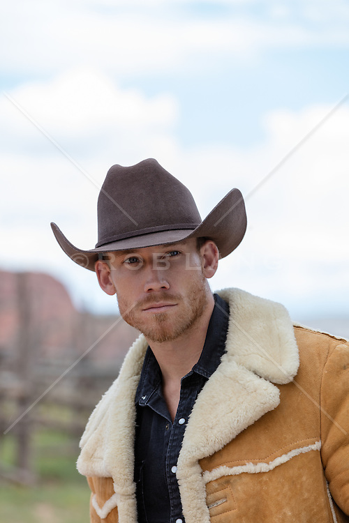 portrait of a rugged All American man in a shearling coat outdoors
