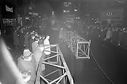 08/02/1963<br /> 02/08/1963<br /> 08 February 1963<br /> New Esso sign being erected at O'Connell Street Dublin. Workmen halt traffic and attract a crowd of onlookers as they begin the assembly of the crane to be used to lift the sign into place.