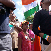 A young girl watches New Castle County Executive Paul Clark addressing the crowd prior to the start of the indian independence day celebrations at the Hindu Temple of Delaware Saturday. August. 18, 2012. in Hockessin Delaware...Indian's around the world celebrates india's 65th anniversary of india's independence from British rule and the country's birth as a sovereign nation on August 15, 1947.