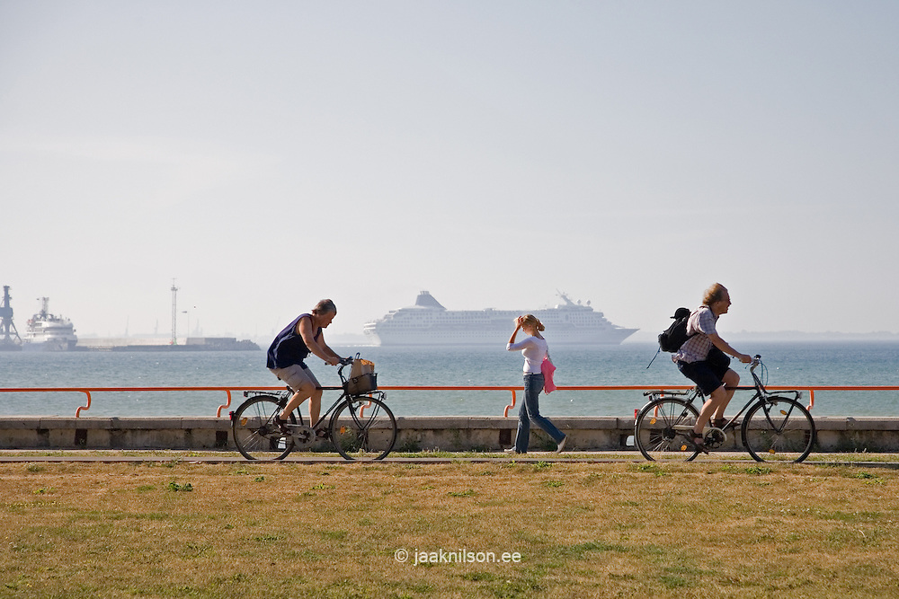 People Riding Bikes by Baltic Sea in Tallinn, Estonia