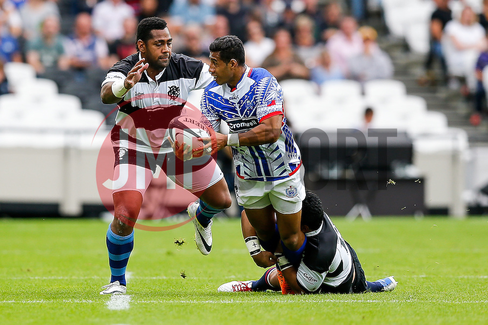 Samoa Winger Ken Pisi is tackled by Barbarians Outside Centre Ben Tapuai (Western Force & Australia) - Mandatory byline: Rogan Thomson/JMP - 07966 386802 - 29/08/2015 - RUGBY UNION - The Stadium at Queen Elizabeth Olympic Park - London, England - Barbarians v Samoa - International Friendly.