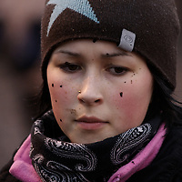Hirvas Salmi, FINLAND.  October 18, 2007.  With flecks of mud and reindeer blood across her cheeks, Annirauna Triumf, 16, corrals her reindeer during an 11 hour day.  She lives in Norway with her mother but comes to Finland for this ?reindeer school? five times a year.  This is a way that youth straddle both the modern day lives while retaining age-old traditions...