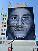 "General overall view of Nike ad featuring former San Francisco 49ers quarterback Colin Kaepernick to commemorate the 30th anniversary of the ""Just Do It"" campaign on the side of building on S. Broadway between Washington and West 18th Street. ""Believe in something,"" the advertisement reads in white letters in front of a black-and-white portrait of Kaepernick. ""Even if it means sacrificing everything."""