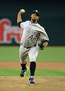 PHOENIX, AZ - APRIL 26:  Pitcher Juan Nicasio #44 of the Colorado Rockies pitches against the Arizona Diamondbacks in the first inning at Chase Field on April 26, 2013 in Phoenix, Arizona.