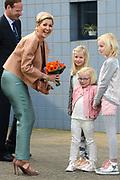 Koningin M&aacute;xima heeft in IJmuiden de Nh1816, een nieuw type reddingboot van de Koninklijke Nederlandse Redding Maatschappij (KNRM) gedoopt.<br /> <br /> Queen M&aacute;xima has inaugurated in IJmuiden Nh1816, a new type of lifeboat of the Royal Dutch Rescue Organisation (KNRM).<br /> <br /> Op de foto / On the photo:  Koningin Maxima ontvangt bloemen bij haar aankomst /// Queen Maxima receives flowers upon her arrival