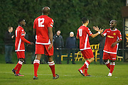 Merstham Midfielder Xavier Vidal celebrates a goal to make it 1-0 during the Ryman Premier League match between Merstham and Burgess Hill at Moatside, Merstham, United Kingdom on 31 December 2016. Photo by Andy Walter.