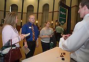 From left: Jill Bean, Andrew Helms, and Sarah Davis stop at the Registrar table during the Ohio Gurantee Event in Walter Hall Rotunda on Oct. 7, 2014. Photo by Lauren