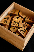 "A set of ""moriage-goma"" raised letter shogi playing pieces. Nakajima Seikichi Shoten, Tendo, Yamagata Prefecture, Japan, February 19, 2018. The city of Tendo in Yamagata Prefecture is famous for its shogi (Japanese chess) playing pieces. Production started early in the 19th century and Tendo still produces over 95% of the Shogi pieces made in Japan."