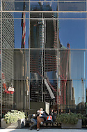 PHOTO PETER PEREIRA/4SEE<br /> <br /> An emotional couple embrace in front of the World Trade Center site.  The new Freedom Tower which is being constructed can be seen reflected in the windows of the Brooks Bros. building.  New Yorkers deal with the 10th anniversary of September 11, 2001 in different ways.
