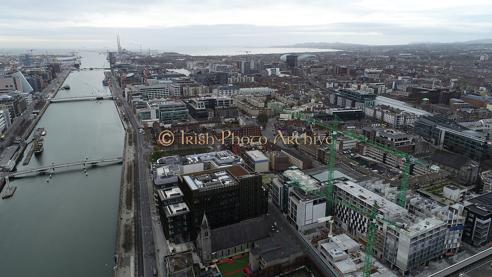 Aerial Photos of Dublin city Centre During Travel Restrictions, 3-4-20, 3rd March 2020, Covid 19, Friday Morning, Rush Hour, showing almost, Empty Streets, as people, curtail all but essential movment, Ireland, and Irish are doing thier best to reduce risk to others, liffey