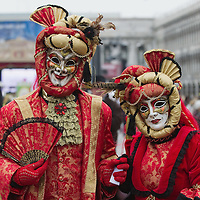 VENICE, ITALY - FEBRUARY 11:  A  couple wearing Carnival costumes poses for pictures in St Mark's Square on February 11, 2012 in Venice, Italy.The annual festival, which lasts nearly three weeks, will see the streets and canals of Venice filled with people wearing highly-decorative and imaginative carnival costumes and masks.