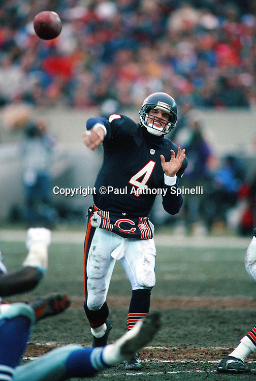 Chicago Bears quarterback Jim Harbaugh (4) throws a pass during the NFL NFC Wild Card playoff football game against the Dallas Cowboys on Dec. 29, 1991 in Chicago. The Cowboys won the game 17-13. (©Paul Anthony Spinelli)