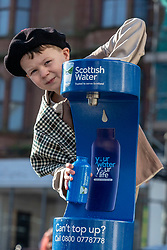 Youngsters paid tribute to one of Dumfries' most celebrated former residents when they unveiled a new water refill tap in the town.<br /> <br /> The high tech Top Up Tap has been installed by Scottish Water as part of its national initiative to encourage people to carry a reusable bottle and stay hydrated on the go. <br /> <br /> Pictured: Corey James Lake from Noblehill Primary School who donned an 18th century outfits and recited some poems by Robert Burns.