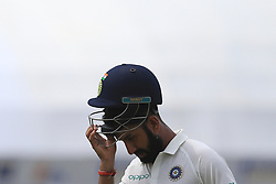 July 27, 2017 - Galle, Sri Lanka - Indian cricketer Cheteshwar Pujara removes his helmet while walking back to the pavilion after his dismissal during  the 2nd Day's play in the 1st Test match between Sri Lanka and India at the Galle International cricket stadium, Galle, Sri Lanka on Thursday 27 July 2017. (Credit Image: © Tharaka Basnayaka/NurPhoto via ZUMA Press)