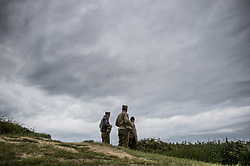 History enthusiasts in uniform peer over the top of the ruins of a German bunker, near the Normandy coast ahead of the 75th D-Day anniversary, in Pointe Du Hoc France, 04 June 2019. World leaders are to attend memorial events in Normandy, France on 06 June 2019 to mark the 75th anniversary of the D-Day landings, which marked the beginning of the end of World War II in Europe. Photo by Eliot Blondet/ABACAPRESS.COM